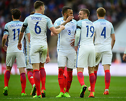 England's Jamie Vardy celebrates with England's Danny Rose and England's John Stones - Mandatory by-line: Alex James/JMP - 26/03/2017 - FOOTBALL - Wembley Stadium - London, England - England  v Lithuania - World Cup Qualifiers Group stage