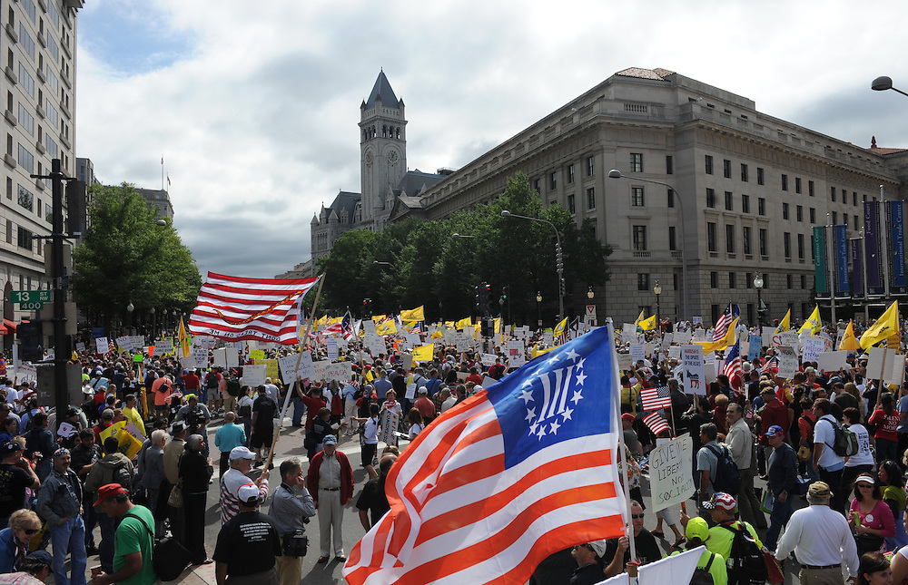 A crowd marches down Pennsylvania Ave. from Freedom Plaza to the U.S. Capitol to have thier voices heard during the Tea Party Protest on Sept. 12, 2009 in Washington, DC.