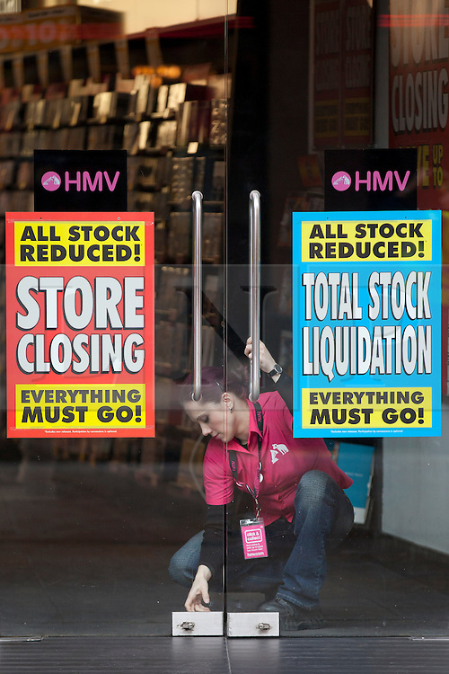 © Licensed to London News Pictures. 20/02/2013. London, UK. An HMV employee unlocks the door of the  Trocadero branch of the struggling music, DVD and games retailer in London today (20/02/2013). The Trocadero branch is one of 66 HMV stores to be closed, with the loss of 930 jobs across the country, after the company's administrators Deloitte admitted they would not be seeking a buyer for the entire business.   Photo credit: Matt Cetti-Roberts/LNP