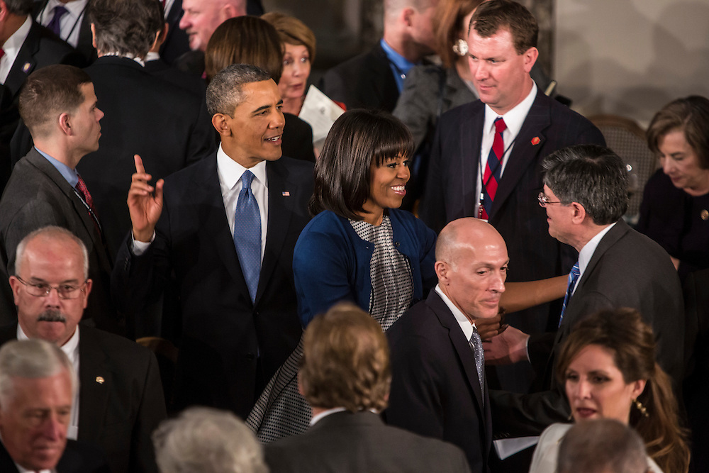 President Barack Obama and First Lady Michelle Obama greet Treasury Secretary nominee Jacob Lew at the Inaugural Luncheon in Statuary Hall at the U.S. Capitol on Monday, January 21, 2013 in Washington, DC.