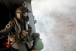 December 21, 2019, Nowra, New South Wales, Australia: Royal Australian Navy Aircrewman BEN NIXON of 808 Squadron, assesses the Tianjara Fire in the Moreton and Jerrawangala National Parks out of an MRH90 Taipan Military Support Helicopter. (Credit Image: © Kelvin Hockey/Royal Australian Navy via ZUMA Wire)