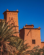 Ait-Ben-Haddou's earthen buildings surrounded by high walls, is a traditional pre-Saharan habitat. The houses crowd together within the defensive walls, which are reinforced by corner towers. Just over the Atlas mountains from Marrakecch in Ouarzazate province, is a striking example of the architecture of southern Morocco
