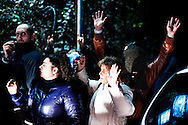 ITALY, Terzigno : Demonstrators that protest against the opening of a new dump on the slopes of Mount Vesuvius raise thei hands after clashes with riot police inTerzigno on October 21, 2010. Naples' latest garbage emergency turned nastier after demonstrators blocked the access to the Terzigno dump, a commune 20 km away of Naples. AFP PHOTO / ROBERTO SALOMONE