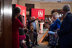 © Licensed to London News Pictures. 14/04/2016. London, UK. Leader of the Labour Party JEREMY CORBYN (centre) poses for a selfie after delivering a speech and Q&A session, arguing the case for Britain remaining in Europe, at Senate House in London. The Uk is due to vote in and in out referendum in their membership of the EU on June 23rd, 2016.  Photo credit: Ben Cawthra/LNP