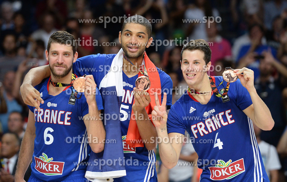 Antoine Diot, Nicolas Batum and Thomas Heurtel of France celebrate after winning bronze medal during the 2014 FIBA World Basketball Championship Third Place match between France and Lithuania at the Palacio de los Deportes, on September 13, 2014 in Madrid, Spain. Photo by Tom Luksys  / Sportida.com <br /> ONLY FOR Slovenia, France