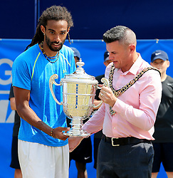Dustin Brown of Germany is presented with the trophy after winning the AEGON Manchester Trophy Mens Final against Yen-Hsun Lu of Chinese Taipei  - Mandatory by-line: Matt McNulty/JMP - 05/06/2016 - TENNIS - Northern Tennis Club - Manchester, United Kingdom - AEGON Manchester Trophy