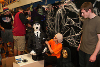 Olivia Edson and Ricky Hughes bring Halloween to life in the Juniors Fall themed hallway Thursday evening in preparation for Gilford High School's Four Seasons Homecoming festivities.  (Karen Bobotas/for the Laconia Daily Sun)