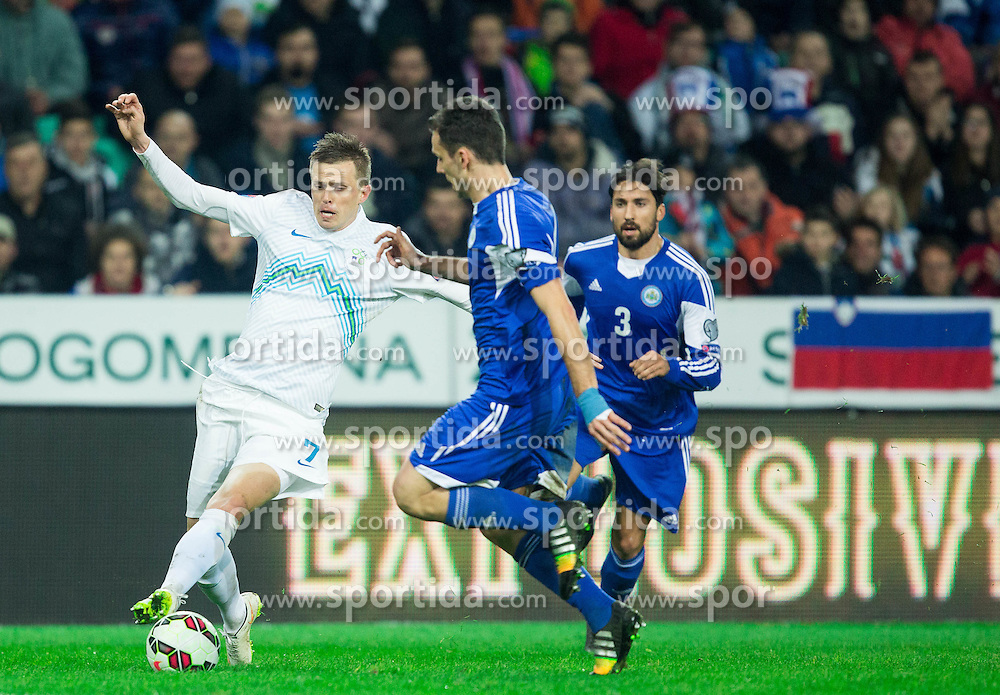 Josip Ilicic of Slovenia vs Cristian Brolli of San Marino during football match between NationalTeams of Slovenia and San Marino in Round 5 of EURO 2016 Qualifications, on March 27, 2015 in SRC Stozice, Ljubljana, Slovenia. Photo by Vid Ponikvar / Sportida