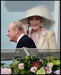 Image ©Licensed to i-Images Picture Agency. 07/06/2014. The Duke of Edinburgh and the Princess Michael of Kent on the phone while on the Royal Balcony after just arriving at the Investec 2014 Espom Derby from Paris. Picture by Andrew Parsons / i-Images