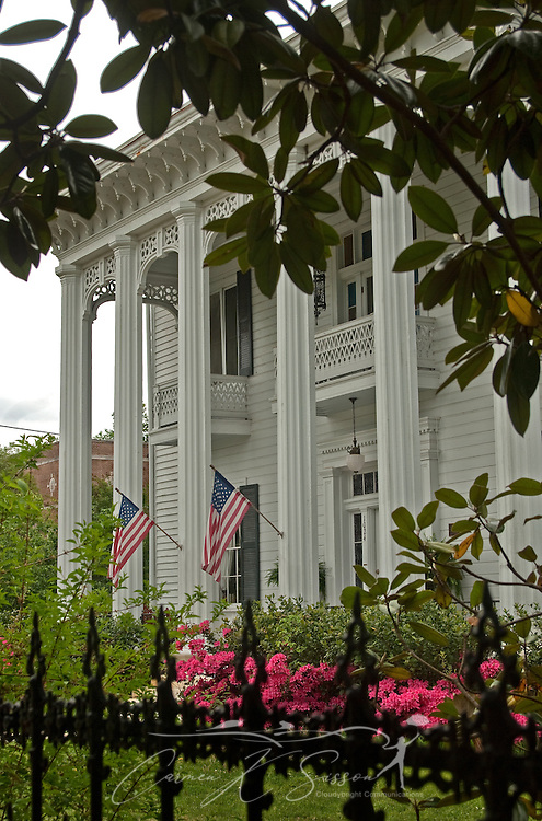 Flags hang from the fluted columns at Shadowlawn in Columbus, Miss. April 19, 2010. The 1848 home, which also serves as a bed and breakfast, was among nearly two dozen on tour during Columbus' annual Spring Pilgrimage. (Photo by Carmen K. Sisson/Cloudybright)