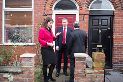 © Licensed to London News Pictures . 04/02/2014 . Sale , UK . L-R Rachel Reeves , Chris Bryant and Mike Kane knock on doors to canvas . Rachel Reeves , MP for Leeds West and Shadow Secretary of State for Work and Pensions and Chris Bryant , MP for Rhondda and Shadow Minister for Welfare Reform , join Labour candidate Mike Kane on the campaign trail ahead of the Wythenshawe and Sale East by-election , following the death of MP Paul Goggins . They visit the home of Tony Gunning (51) who suffers from hereditary adult polycystic kidney disease and is on dialysis , who says he is affected by the bedroom tax . Photo credit : Joel Goodman/LNP