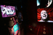 TV screens showing people climaxing and during intercourse in the Orgasm Tunnel at Amora, the Academy of Sex and Relationships, on Tuesday, April 17, 2007, in London, UK. The world's first visitor attraction dedicated to love, sex and relationships opens its door officially tomorrow (18th of April 2007) in Piccadilly. The permanent interactive attraction, Amora, expects to draw over half a million, 18+ visitors in the first year and fuses entertainment, excitement and education in a unique powerful sensory experience. With seven zones covering every aspect of relationships from first filtrations and dating to fantasy and fetish. Visitors can explore the science of attraction - what they find attractive and why, learn how to enhance their skills and even create what their perfect partner might look like. Male and female models help demystify erogenous zones, G-spot and prostate, while insights and technique tips are offered on various topics. Sexual awareness and well-being are also covered thoroughly. **Italy Out**