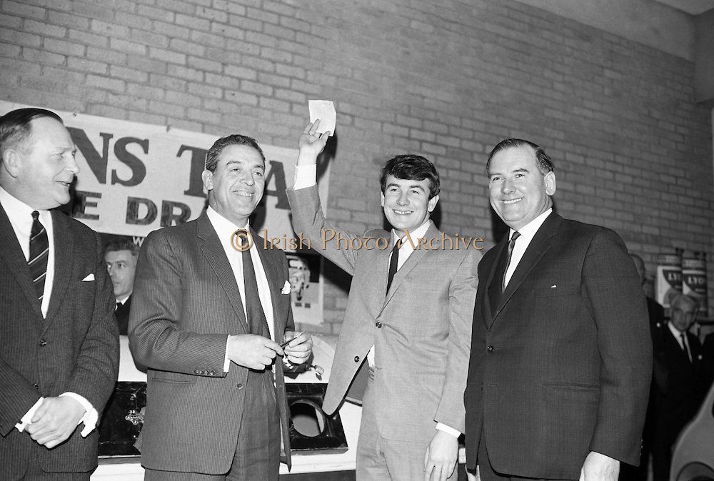 Butch Moore, lead singer with the Capitol Showband, pulls the winning name in the 14th Lyons Tea Free Draw, with (2nd left) stage, film and TV actor Eddie Byrne. Also in the picture are Joint Managing Directors of Lyons, Mr Jim O'Meara (right) and Mr George Patterson ( left). .28.02.1966