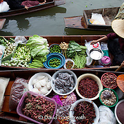 Scenes from Damnoensaduak floating market on the outskirts of Bangkok.