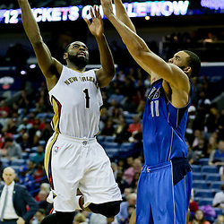 Jan 6, 2016; New Orleans, LA, USA; New Orleans Pelicans guard Tyreke Evans (1) shoots over Dallas Mavericks center JaVale McGee (11) during the second half of a game at the Smoothie King Center. The Mavericks defeated the Pelicans 100-91. Mandatory Credit: Derick E. Hingle-USA TODAY Sports