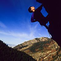 Craig Berman climbing Megalopolis, 5.11a in early morning light, Big Cottonwood Canyon, Utah