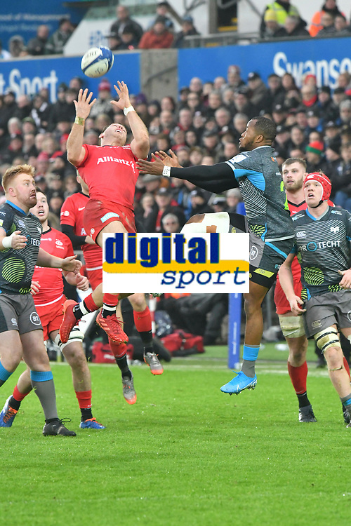Rugby Union - 2019 / 2020 European Rugby Heineken Champions Cup - Pool Four: Ospreys vs. Saracens<br /> <br />  Alex Lewington of Saracens leaps for the ball, at the Liberty Stadium.<br /> <br /> COLORSPORT/WINSTON BYNORTH