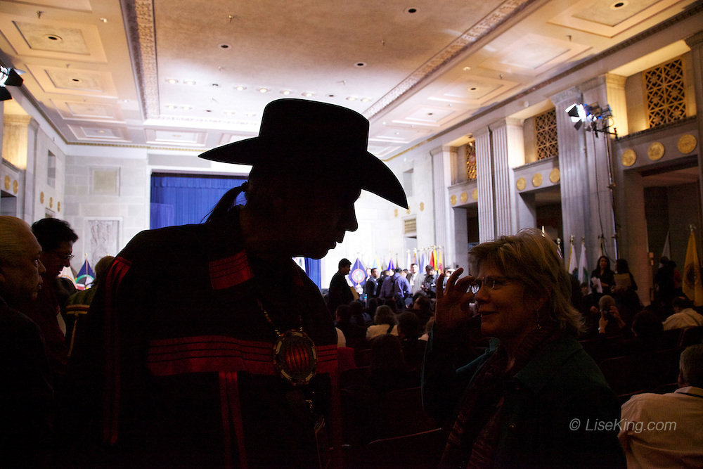 Tex Hall, Chairman of the Three Affiliated Tribes, silhouetted in his ubiquitous cowboy hat.