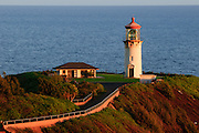 Kilauea Lighthouse on the island of Kauai, Hawaii lit by early morning sunlight.