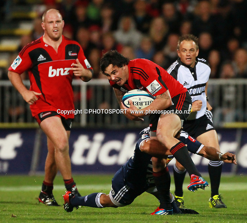 Crusaders player Zac Guildford is tackled by Stormers player Juan de Jongh. Super Rugby game between the Crusaders and the Stormers. Crusaders new Christchurch Stadium at Rugby League Park, Saturday 14 April 2012. Photo : Joseph Johnson / photosport.co.nz