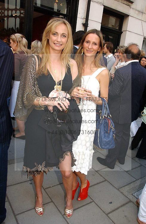 Left to right, CLEMENTINE HAMBRO and AMANDA CROSSLEY at a private view of artist Damian Elwes work 'Artists Studios' held at Scream, 34 Bruton Street, London W1 on 29th June 2006.<br /><br />NON EXCLUSIVE - WORLD RIGHTS