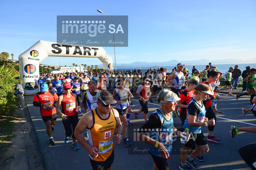 MOSSEL BAY, SOUTH AFRICA - SEPTEMBER 24: athletes at the start of the 21,1km half marathon during the PetroSA Marathon finishing at Santos Caravan Park on September 24, 2016 in Mossel Bay, South Africa. (Photo by Roger Sedres/Gallo Images)
