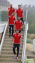 DINARD, FRANCE - Tuesday, June 7, 2016: Wales players make their way down a staircase for a team group photograph at the Novotel Thalasso Dinard ahead of the start of the UEFA Euro 2016 tournament. James Collins, Danny Ward, Joe Allen, Ashley Richards and Chris Gunter. (Pic by Paul Greenwood/Propaganda)