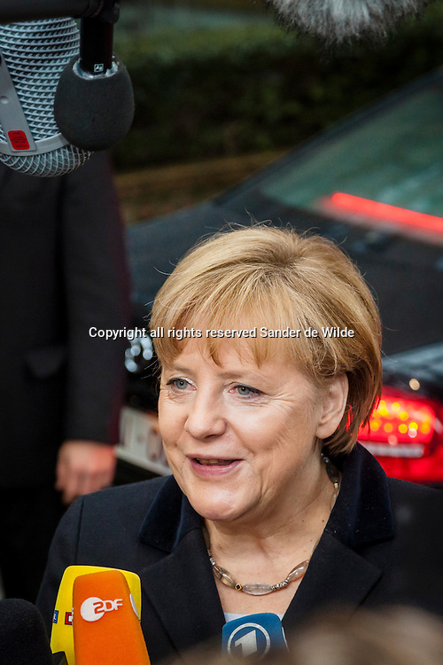 German Chancellor Angela Merkel speaks to the press arriving at an EU summit in Brussels on Friday, Nov. 23, 2012. The leaders of Britain and France staked out starkly different visions of Europe's future as talks in Brussels on how much the European Union should be allowed to spend, set the stage for a long, divisive and possibly inconclusive summit.