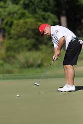 Former NC State football and baseball standout Terry Harvey putts during the Chick-fil-A Peach Bowl Challenge at the Ritz Carlton Reynolds, Lake Oconee, on Tuesday, April 30, 2019, in Greensboro, GA. (Chris Collins via Abell Images for Chick-fil-A Peach Bowl Challenge)