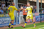 Leeds no 10 Alex Mowatt celebrates the first goal in the  Friendly match between Peterborough United and Leeds United at London Road, Peterborough, England on 23 July 2016. Photo by Nigel Cole.