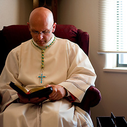 042309     Brian Leddy.Bishop James Wall prays before his ordination ceremony on Thursday at Sacred Heart Cathedral. Wall was appointed by Pope Benedict XVI to head the diocese.