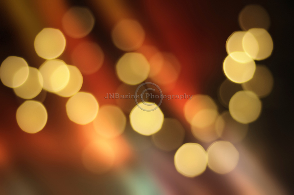 Sparkling lights in front of silky, colourful curtain.