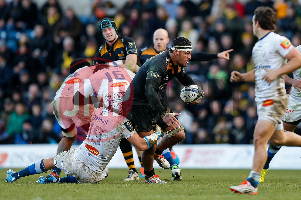 Wasps Number 8 Nathan Hughes is tackled by Castres Olympique replacement William Whetton - Photo mandatory by-line: Rogan Thomson/JMP - 07966 386802 - 14/12/2014 - SPORT - RUGBY UNION - High Wycombe, England - Adams Park Stadium - Wasps v Castres Olympique - European Rugby Champions Cup Pool 2.