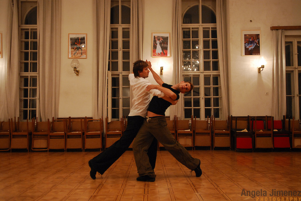 "World Champion same-sex ballroom dancers Robert Tristan Szelei, right, and Gergely Darabos practice their routines at a lesson session at Leovey Klara High School in Budapest, Hungary on October 18, 2006, in preparation for the 2nd annual World Championship Same-Sex Ballroom Dancing competition, which was held in their hometown on October 21, 2006. ..This lesson session, taught by a former Hungarian opposite-sex champion, is one of the few spaces in Budapest which allows same-sex couples to train. Szelei and Darabos negotiated for the session to be open to them and other same-sex dancers who came to town for the competition. ..The dance couple, known as the ""Black Swans,"" are the reigning world champions in men?s Latin same-sex ballroom dancing. They have been training and preparing to host the 2nd annual World Championship and the Csardas Cup, the first-ever Eastern European same-sex ballroom competition, both held at the Korcsarnok arena.  This is the pinnacle event of the blossoming same-sex ballroom scene...Szelei and Darabos went on to win the men?s Standard division and finished fourth in the Latin division. ..The event was organized by the US-based World Federation of Same-Sex Dancing, which hosted the first World Championship Same-Sex championships in 2005 in Sacramento, California. The Black Swans did a large amount of the coordination and planning in Budapest, a city that had never seen an event of this kind. When government funding fell through, they secured funding from patron Desire (accent on the ?e?) Dubounet, owner of the local Club Bohemian Alibi drag club. ..The World Championship events are newly recognized, but same-sex dancers have been competing on a national and international circuit for a number of years, especially in Europe, including at the Eurogames, the Gay Games, the London Pink Jukebox Trophy and the Berlin Open, among others. Countries including the United States, the Netherlands, Germany and, now, Hungary, hold their own national sam"
