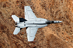 United States Navy Boeing F/A-18E Super Hornet (NH-203) from VFA-14 Tophatters squadron from Naval Air Station Lemoore flies low level through the Jedi Transition, Star Wars Canyon, Death Valley National Park, California, United States of America