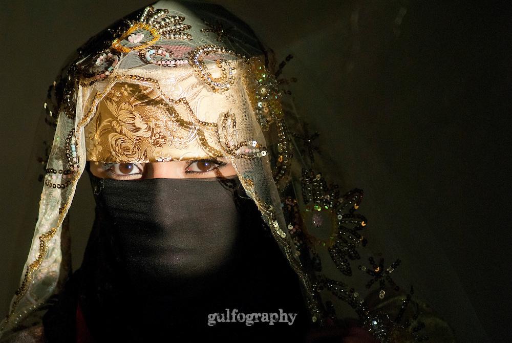 """Ms. Sana'a"" by Amira Al Sharif.  Yemeni woman in traditional clothing in Sana'a, Yemen,"