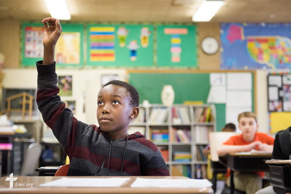 Student Dominique Brown raises his hand during class at Lutheran Special School & Education Services, located in Milwaukee Lutheran High School, on Tuesday, May 19, 2015, in Milwaukee, Wis. LCMS Communications/Erik M. Lunsford