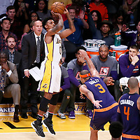 06 November 2016: Los Angeles Lakers guard Nick Young (0) takes a jump shot over Phoenix Suns forward Jared Dudley (3) during the LA Lakers 119-108 victory over the Phoenix Suns, at the Staples Center, Los Angeles, California, USA.