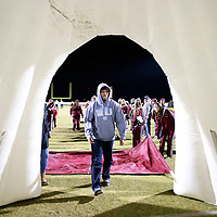 Thomas Wells | BUY AT PHOTOS.DJOURNAL.COM<br /> Dayan Moore helps set up the Smithville Tepee for the team to run through before Friday's game against Kennedy.