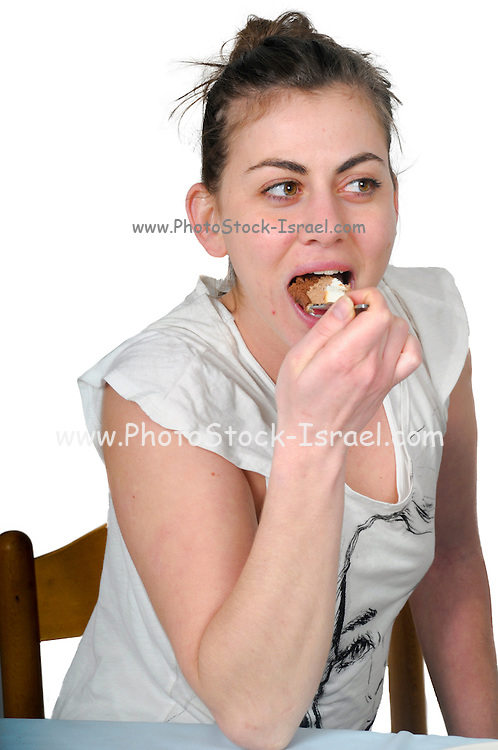 Woman in casual clothes eats cream cake