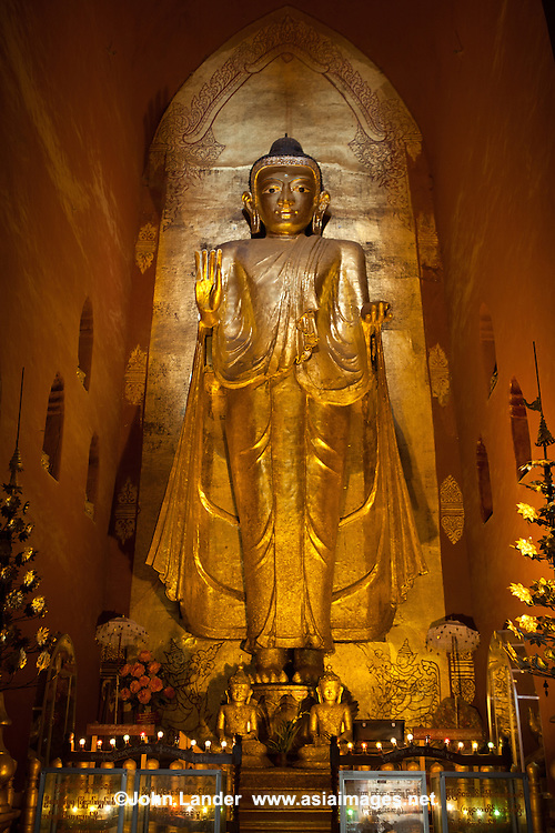 Gilt Buddha at Ananda Temple one of the best preserved of the Bagan temples. Built around 1105 by King Kyanzittha, this perfectly proportioned temple follows the stylistic end of the Early Bagan period and the beginning of the Middle Bagan period