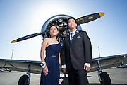 A couple poses for prom portraits at the Palo Alto Airport in Palo Alto, California, on April 23, 2016. (Stan Olszewski/SOSKIphoto)
