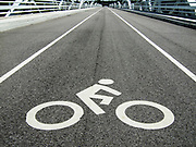 Bicycle lane with an abstract graphic sign of a bicycle with rider