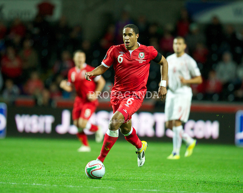 SWANSEA, WALES - Friday, October 7, 2011: Wales' Ashley Williams in action against Switzerland during the UEFA Euro 2012 Qualifying Group G match at the Liberty Stadium. (Pic by David Rawcliffe/Propaganda)