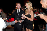 DOV KONETZ; BRITNEY NORRIS, Hosted by Interview Russia.  On behalf of Ferrari, Peter M. Brant and SothebyÕs Tobias Meyer party in honor of FerrariÕs Chairman, Luca di Montezemolo, 1111 Lincoln Road, the iconic car-park in the shopping mall designed by the Pritzker prize winning team Herzog & de Meuron.,  Miami Beach. 29 November 2011.<br /> DOV KONETZ; BRITNEY NORRIS, Hosted by Interview Russia.  On behalf of Ferrari, Peter M. Brant and Sotheby's Tobias Meyer party in honor of Ferrari's Chairman, Luca di Montezemolo, 1111 Lincoln Road, the iconic car-park in the shopping mall designed by the Pritzker prize winning team Herzog & de Meuron.,  Miami Beach. 29 November 2011.