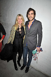 PIPPA HOLT and OSCAR HUMPHRIES at the Prada Congo Art Party hosted by Miuccia Prada and Larry Gagosian at The Double Club, 7 Torrens Street, London EC1 on 10th February 2009.