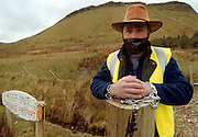 A bound and gagged Andy Mc Sharry, who is making a silent protest against hillwalkers who trespass on his property in Gleniff, Co. Sligo yesterday. Photo: James Connolly/GreenGraph