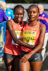 Mary Wacera, Kenya, Nike, wins 1:10:21 and congratulates runner-up Cynthia Limo