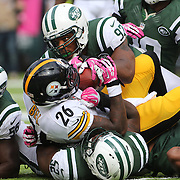 Le'Veon Bell, Pittsburgh Steelers, is tackled by Calvin Pace, (top) and the New York Jets defense during the New York Jets V Pittsburgh Steelers NFL regular season game at MetLife Stadium, East Rutherford, NJ, USA. 13th October 2013. Photo Tim Clayton