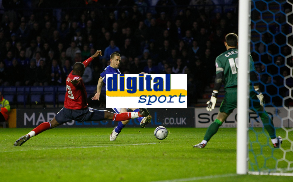 Photo: Steve Bond/Richard Lane Photography. Leicester City v West Bromwich Albion. Coca Cola Championship. 07/11/2009. Matty Fryatt (C) shoots. Abdoulaye Meite stretches in to block